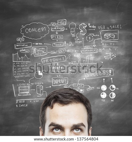 businessman and global business concept on blackboard - stock photo