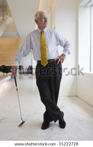 Businessman and golf club - stock photo