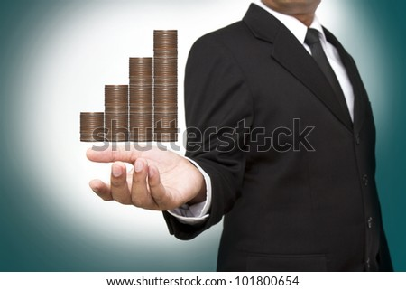 businessman and graph from money - stock photo