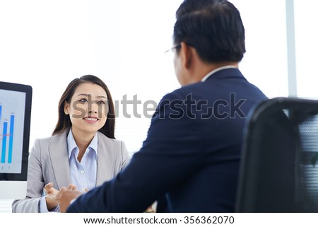 Businessman and his female colleague having meeting in the office - stock photo