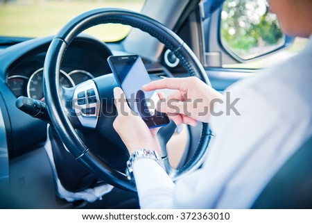 businessman and hold phone in car, man using phone while driving the car, vintage color tone