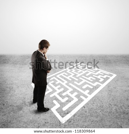 businessman and labyrinth with arrow - stock photo