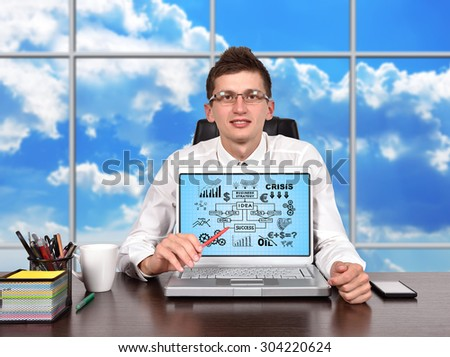 Businessman and laptop with business  scheme on screen - stock photo