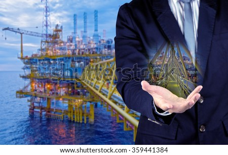 businessman and offshore rig concept - stock photo