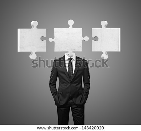 businessman and puzzle pieces - stock photo