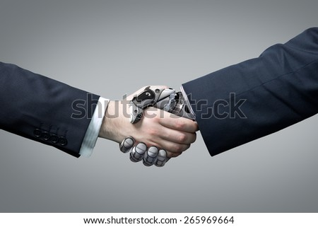 Businessman and robot's handshake. Artificial intelligence technology - stock photo