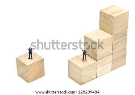 Businessman and Stairs of square blocks. (on white background) - stock photo