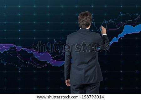 Businessman and stock market - stock photo