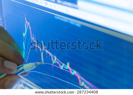 businessman and stock market graph and bar chart price display,Businessman failure in stock market,in blue style - stock photo