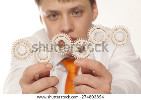 Businessman and teamwork concept with gear in hand - stock photo