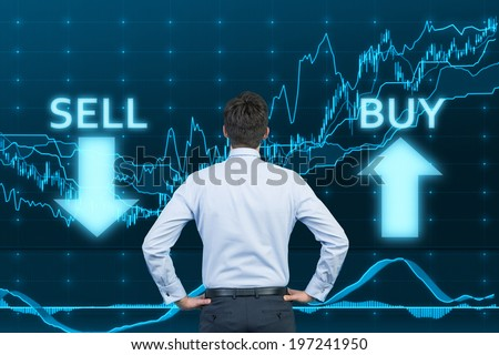 Businessman and the choice 'sell' or 'buy'  - stock photo