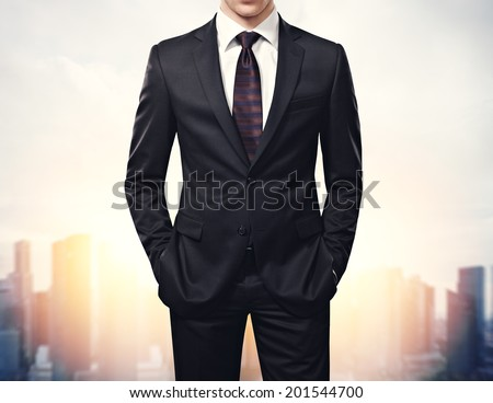 Businessman and the city - stock photo