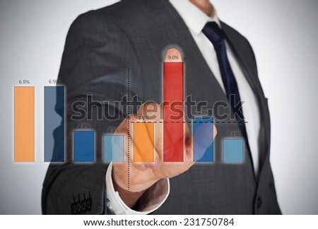 Businessman and virtual graphic - stock photo