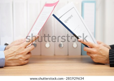 businessman and woman are reading agreement - stock photo