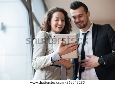 businessman and woman discussing with table  in office