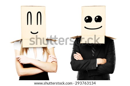 businessman and woman with smiling box on head - stock photo