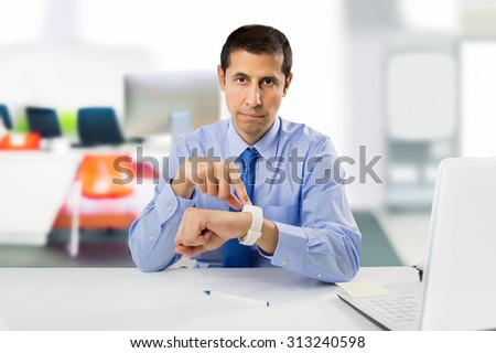 businessman angry and pointing his watch as concept of arrive late at the work