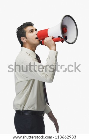Businessman announcing into a megaphone