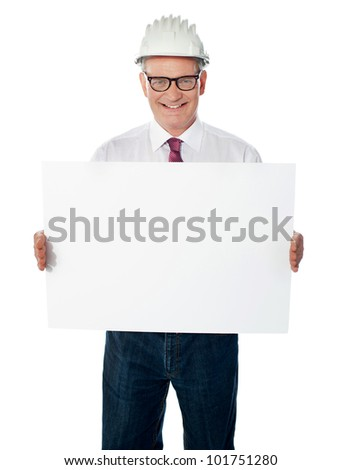 Businessman architect holding a blank white signboard. Senior