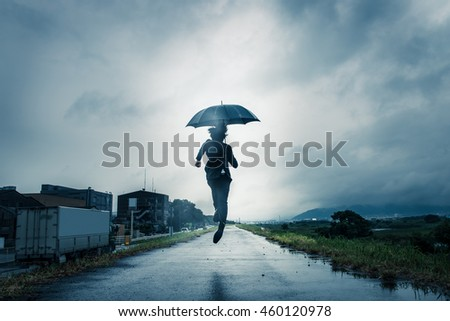 businessman are holding an umbrella