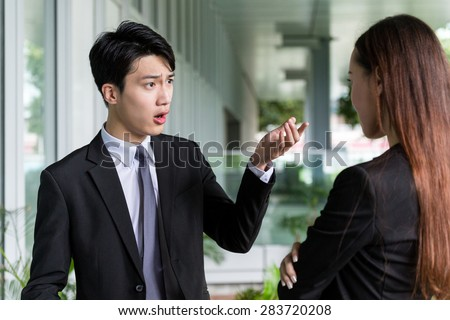 Businessman argue with his assistant - stock photo