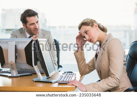 Businessman arguing with a colleague at work - stock photo