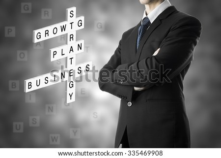 Businessman Arm Cross Crossword Puzzle With Keyword, Business, Plan, Growth - stock photo