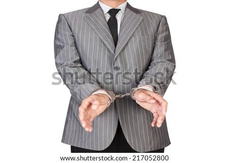 businessman arrested with handcuffs isolated on white background with clipping path - stock photo