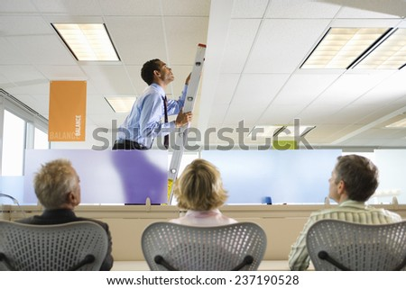Businessman Ascending Corporate Ladder - stock photo