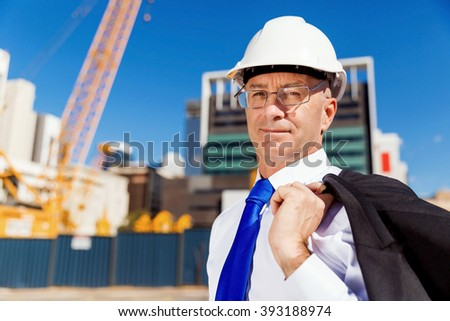 Businessman at construction site - stock photo
