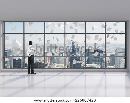 Businessman at the contemporary Manhattan office looking at the city.