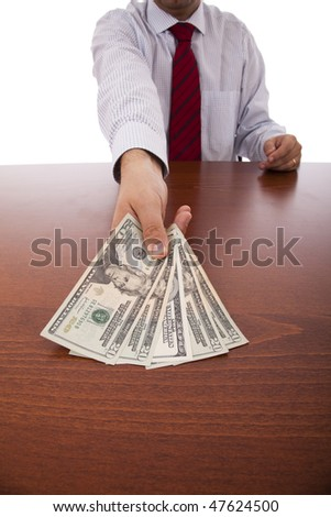 businessman at the office giving money - stock photo
