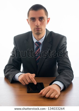 businessman at the table uses a digital tablet
