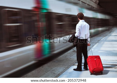businessman at the train station - stock photo