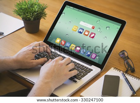Businessman at work. Close-up top view of man working on laptop with computer. all screen graphics are made up. - stock photo
