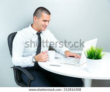 businessman at work , drinking coffee and using computer