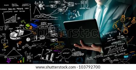 Businessman at work with ne ideas - stock photo