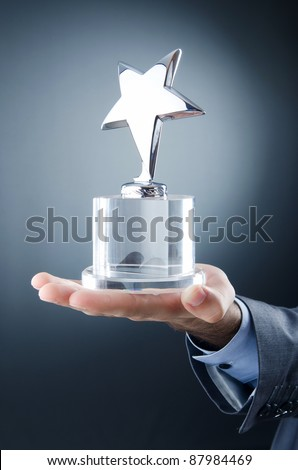 Businessman awarded with star award - stock photo
