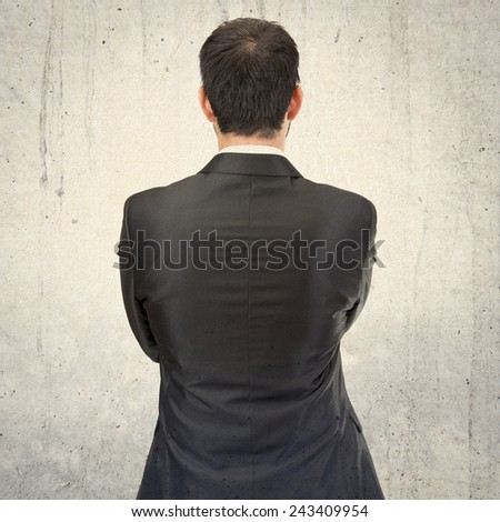 businessman back over isolated white background - stock photo