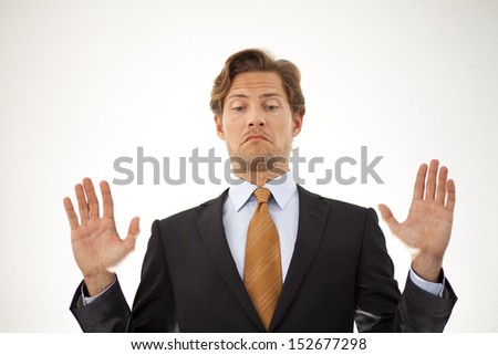 Businessman backing out of a deal or refusing to participate - stock photo