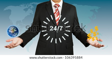 Businessman balance earth and dollar for 24 hours. Elements of this image furnished by NASA. - stock photo