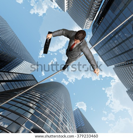 businessman balancing on a rope - stock photo