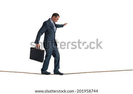 businessman balancing on a tightrope isolated on white - stock photo