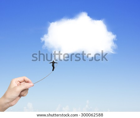 Businessman balancing on tightrope woman hand pulling, walking toward white cloud in blue sky.