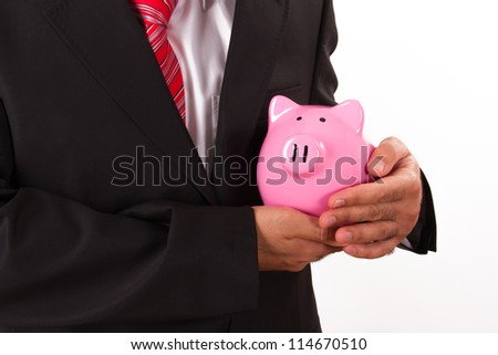 Businessman behaving piggy bank like a baby, isolated on white background.