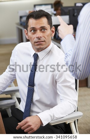 Businessman Being Shouted At By Female Colleague - stock photo