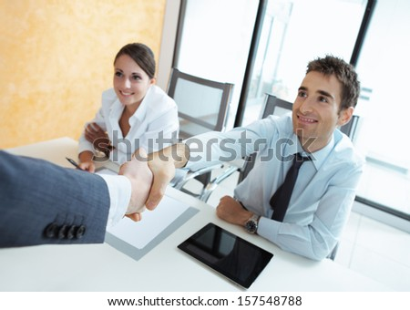 Businessman being welcomed into the company by his new colleagues  - stock photo