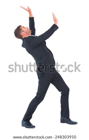 Businessman bending and pushing on white background