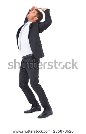 Businessman bending and pushing on white background - stock photo