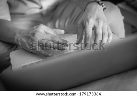 Businessman Black & White : Two hands are working on laptop. - stock photo